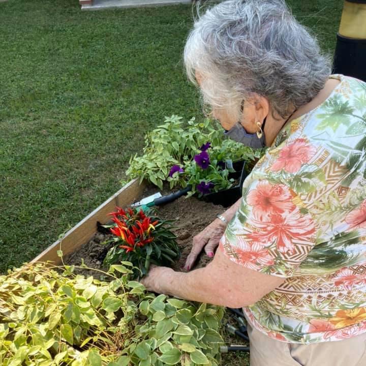 Autumn Ridge Residences | Senior tending to the garden