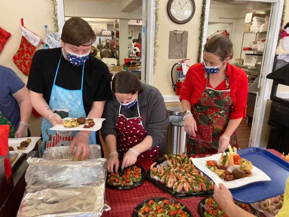 Autumn Ridge Residences | Associates organizing holiday buffet